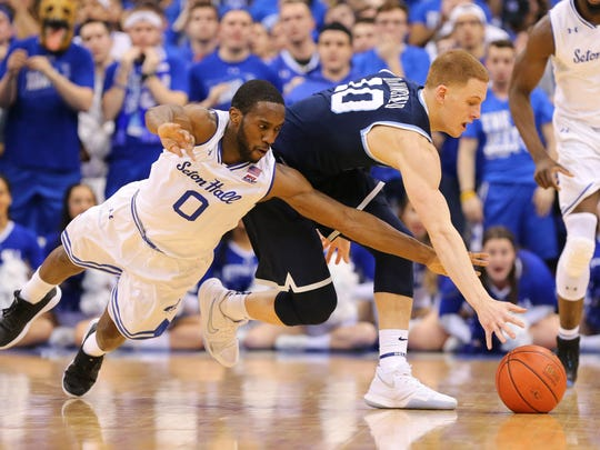 Seton Hall Pirates guard Khadeen Carrington (0) battles Villanova Wildcats guard Donte DiVincenzo (10)