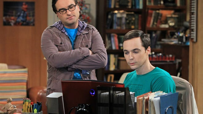 """This image released by CBS shows Johnny Galecki, left, and Jim Parsons in a scene from """"The Big Bang Theory."""" The series was nominated for a Golden Globe for best musical or comedy series on Thursday, Dec. 13, 2012. The 70th annual Golden Globe Awards will be held on Jan. 13.  (AP Photo/CBS, Sonja Flemming) ORG XMIT: NYET707"""