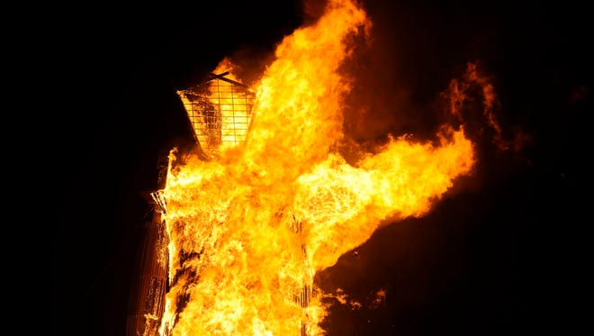 The man burns at the annual Burning Man event on the Black Rock Desert of Gerlach, Nevada on August 30, 2014.