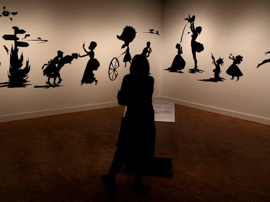 "Silhouettes titled ""Camptown Ladies"" by Kara Walker"
