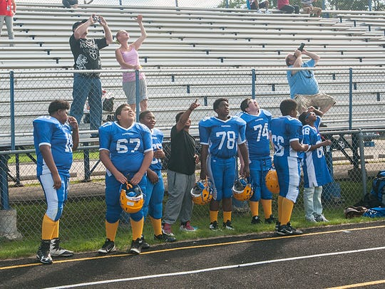 Members of Hilbert Middle School's football team watch