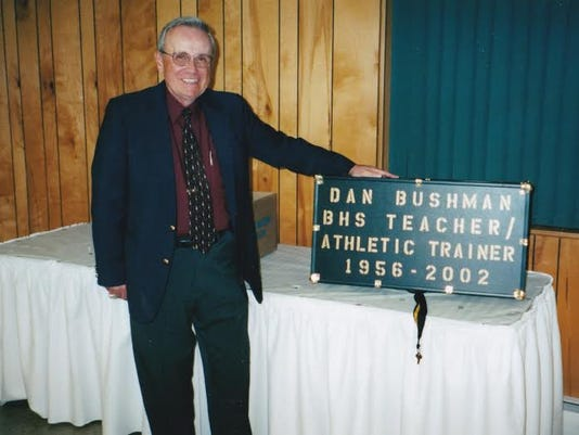 Dan Bushman poses with a plaque outlining his time at Biglerville High School.