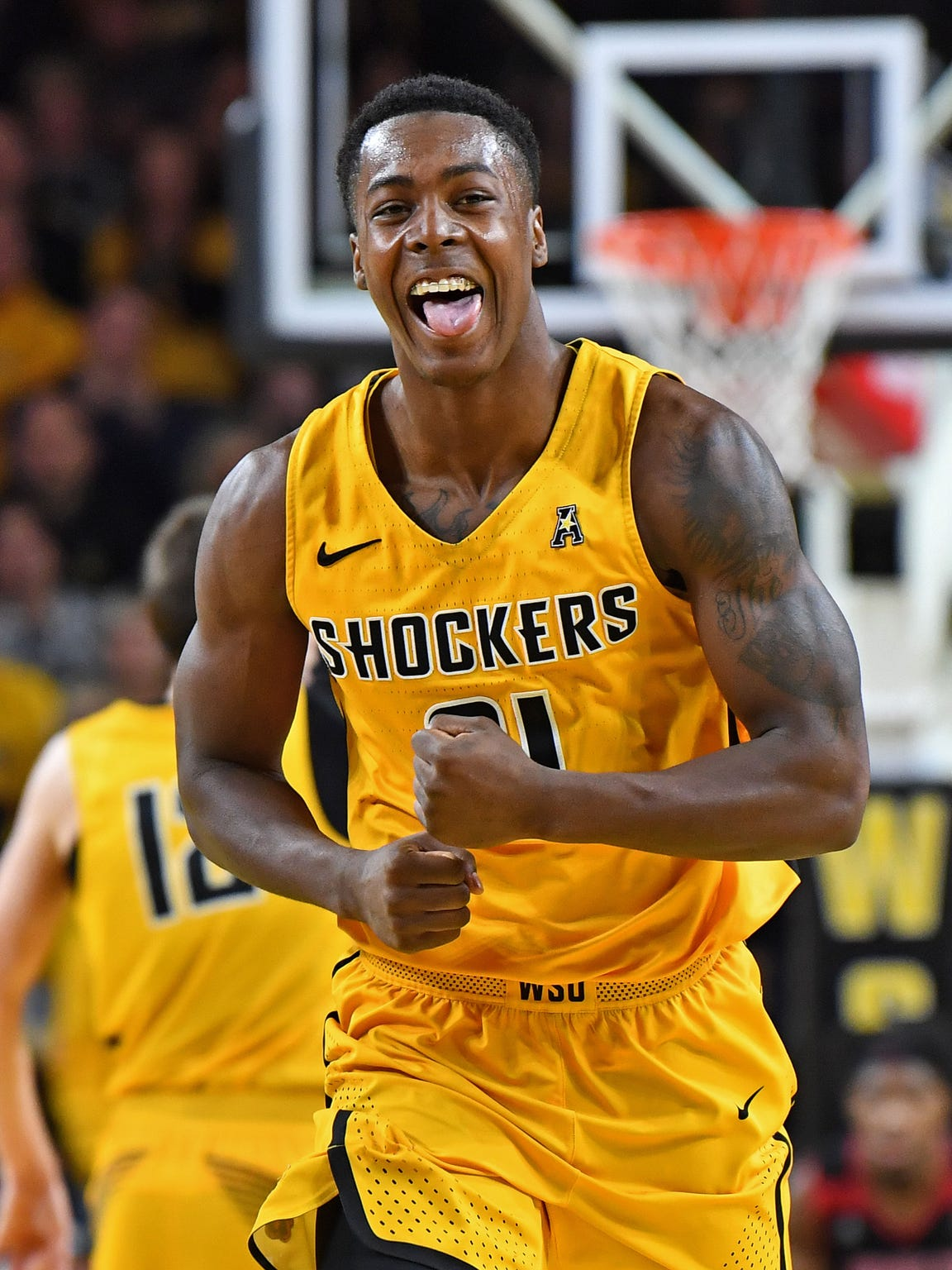 Dec. 19: Wichita State Shockers forward Darral Willis Jr. (21) reacts after a dunk against the Arkansas State Red Wolves during the second half at Charles Koch Arena.