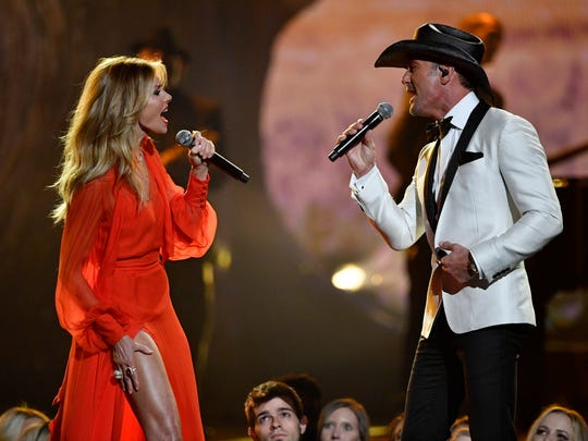 Faith Hill and Tim McGraw perform during the CMA Awards
