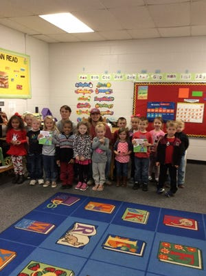 Shown are teacher cadets, Ben Perry and Beau Shaw with K4 students at West Pelzer Elementary School.