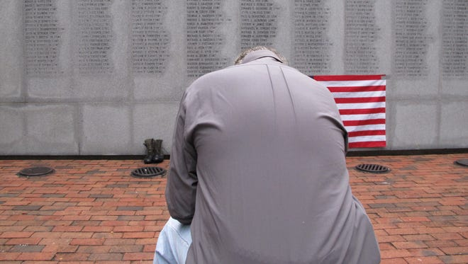 Former Marine Ed Ayers of Scranton, Penn., hangs his head and weeps at the Beirut Bombing Memorial in Jacksonville, N.C., in 2013 on the 30th anniversary of the terrorist bombing that killed 241 U.S. service members.