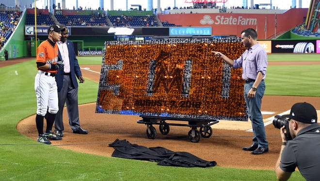 The Miami Marlins' Ichiro Suzuki is honored during a pregame ceremony for Suzuki's 3,000 career hit last year.