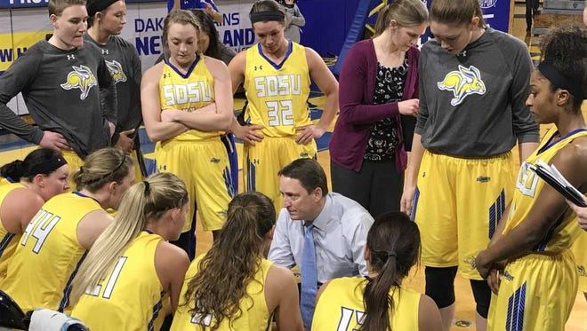 SDSU coach Aaron Johnston huddles with his team during a timeout of Wednesday's win over Omaha at Frost Arena.