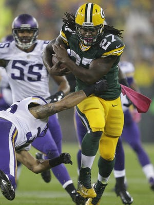 Green Bay Packers running back Eddie Lacy runs for a first down against Minnesota Vikings strong safety Robert Blanton in the first quarter.