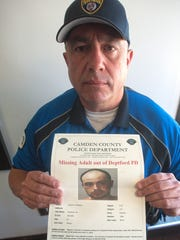 Miguel Martinez Jr. shows a photo of his missing son, Miguel III, in a 2017 file photo.