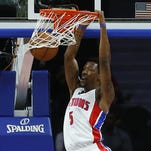 Guard Kentavious Caldwell-Pope dunks against Brooklyn on Oct. 8 at the Palace.