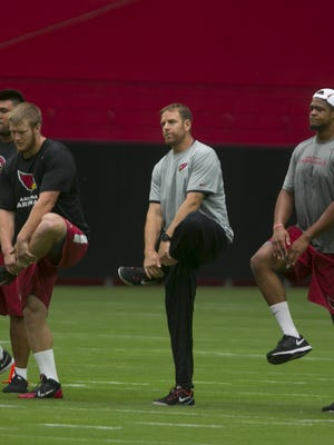 Cardinals' Carson Palmer warms up at the first day of camp in Glendale, AZ on July 31, 2015.