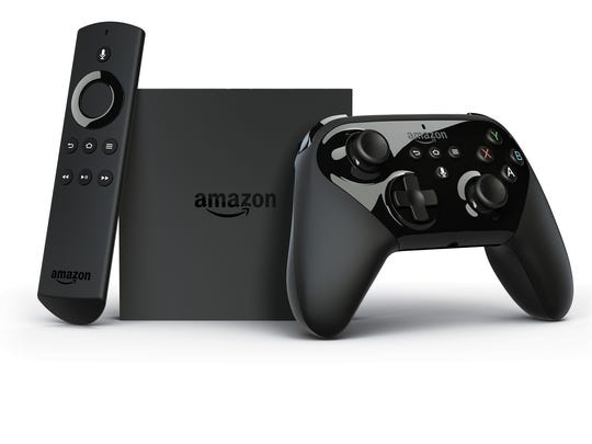 This photo provided by Amazon shows the Amazon Fire TV with voice remote and controller.