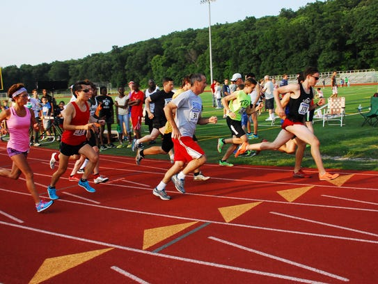 Runners take part in the 2014 Twilight Track Series