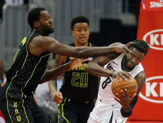 Memphis Grizzlies forward James Ennis III (8) is defended