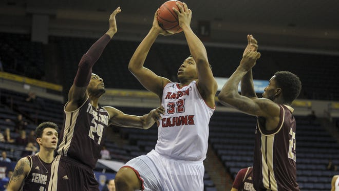 Power forward Bryce Washington (32), shown here taking the ball to the basket in UL's 2015 Sun Belt Conference Tournament win over Texas State in New Orleans, leads the SBC in field goal percentage this season. UL and Texas State meet Thursday night at the Cajundome.