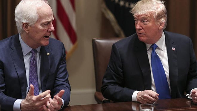 Like nearly all of his Republican colleagues, U.S. Sen. John Cornyn, left, treads softly when reacting to comments made by President Donald Trump.