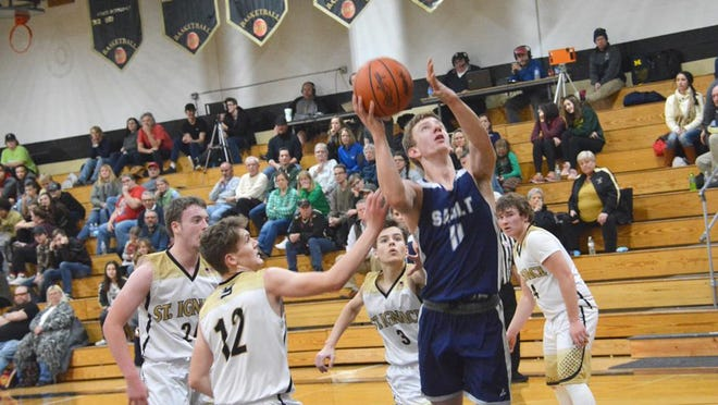 Sault High's Bennette Swanson (11) puts up a shot during a game against St. Ignace last season. The Blue Devils are scheduled to open the 2021 season at home against Newberry on Friday, Jan. 22.