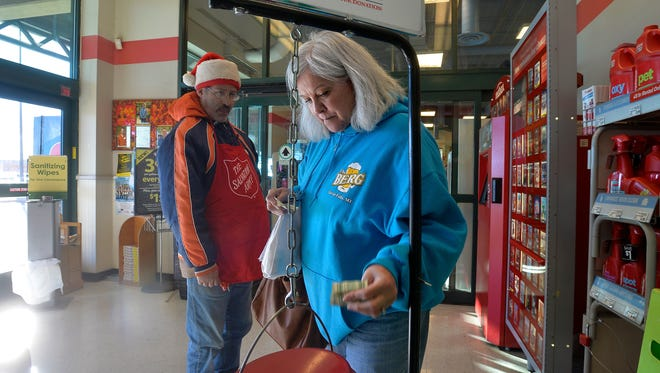 Gail Cook donates to the Salvation Army at Smith's grocery store on Tuesday afternoon.  Tuesday was the National Day of Giving.