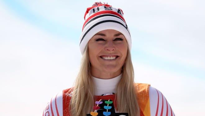 Lindsey Vonn  celebrates winning the bronze medal in the women's downhill.