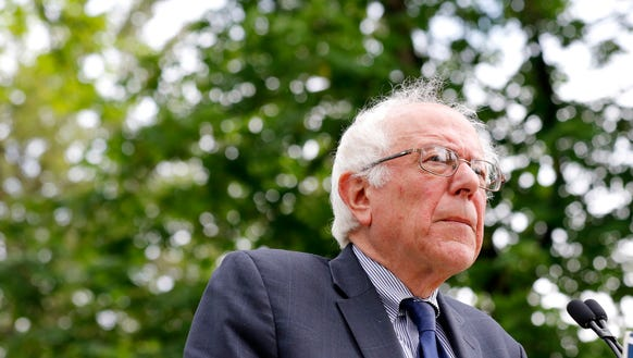 Bernie Sanders looks to the crowd during a rally in