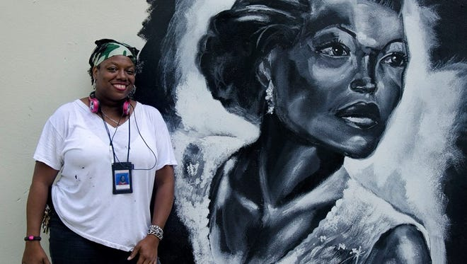 Dalhia Perryman of West Palm Beach tied for first place in the 3rd Annual Back Alley Mural Festival competition.