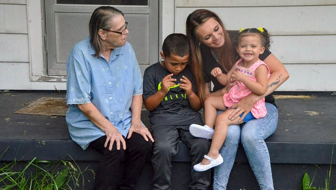 Ruth Levey (from left) sits with her great-grandson Braylen Brown, granddaughter Elizabeth Brown and great-granddaughter Brynlee West.