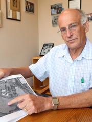 Greenburgh town Supervisor Paul Feiner shows Regeneron's