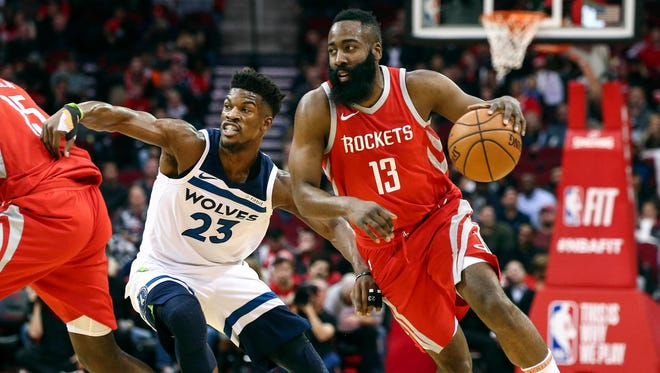 Houston Rockets guard James Harden (13) dribbles the ball as Minnesota Timberwolves guard Jimmy Butler (23) defends during the first quarter at Toyota Center.