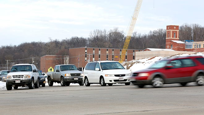 Students leaving St. Mary's Springs High School wait for traffic on Highway 23.