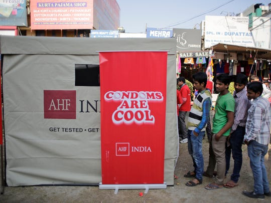 Indians in in New Delhi, India, wait in line for a