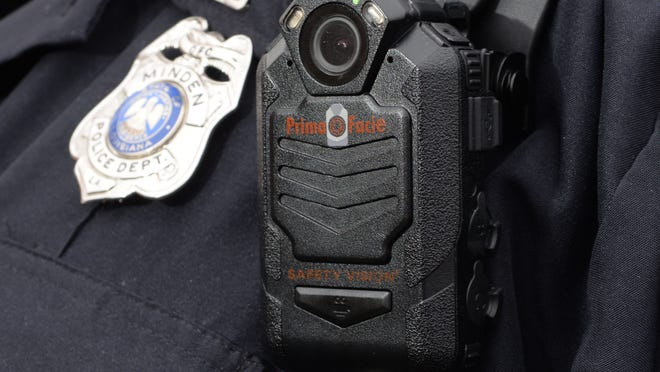 The lens of the body cam is visible in this unit's radio microphone worn by law enforcement . The Minden Police Department is currently testing the unit.