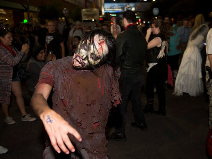 Zombies participate in Zombie Walk in downtown Phoenix