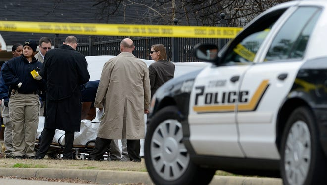 Montgomery Police work the scene of a shooting homicide on Mill Street in Montgomery, Ala. on Thursday January 22, 2015.