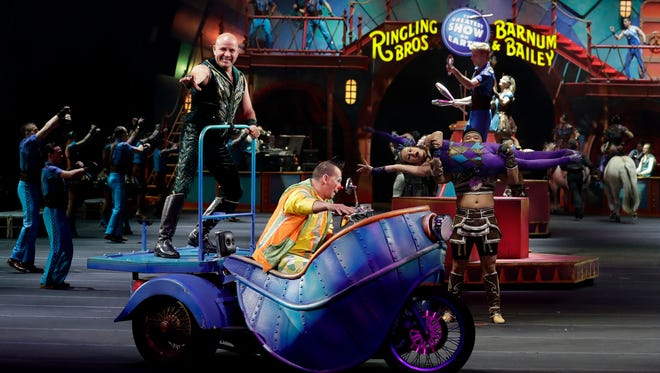 """Ringling Bros. and Barnum & Bailey performers begin a show Saturday, Jan. 14, 2017, in Orlando, Fla. The Ringling Bros. and Barnum & Bailey Circus will end the """"The Greatest Show on Earth"""" in May, following a 146-year run of performances. Kenneth Feld, the chairman and CEO of Feld Entertainment, which owns the circus, told The Associated Press, declining attendance combined with high operating costs are among the reasons for closing."""