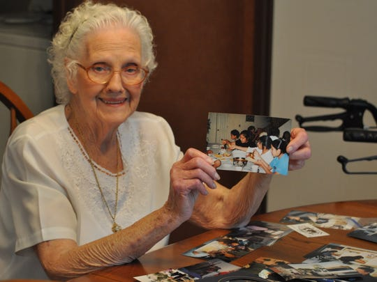 Lazelle Powell, 89, of Tioga is the president of Christ for All Nations, which is a mission she started for the Navajo Indians in New Mexico. She is unable to live in New Mexico now, but holds one of her pictures, which daily remind her of the people there.