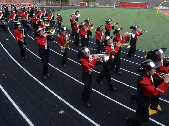 Richmond High School band members practice Wednesday on Lyboult Field as students prepare for a performance at Walt Disney World in Florida.