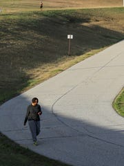 Monique Darby, below, of Anderson, walks on the lower side on Thursday while Shannon Johnson walks on the higher side of the McCants walking track in Anderson.