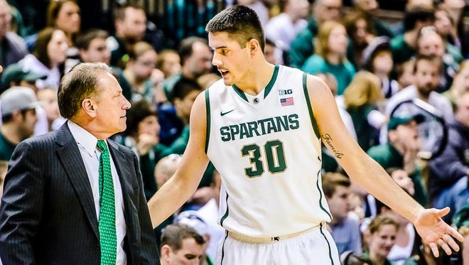 MSU coach Tom Izzo has a few words with Kenny Kaminski during their game against New Orleans.
