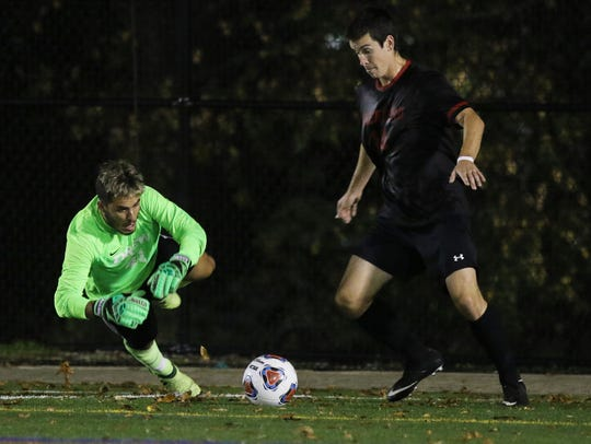 Roxbury alumnus Jason Adamo makes a save as Drew beat