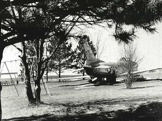 A fighter jet sat in Lions Park in the late 1950s and early 1960s. The cornfield in the background is the location of the current Urbandale High School.