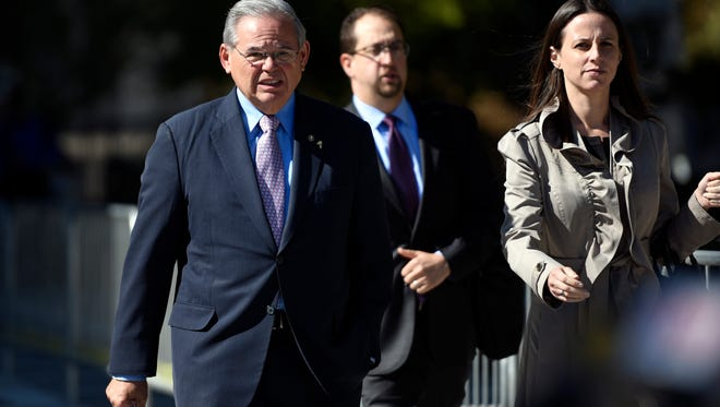 U.S. Sen. Bob Menendez, left, leaves court in Newark on Oct. 4 with his press secretary, Steven Sandberg, and daughter Alicia Menendez during his ongoing trial on federal corruption charges.