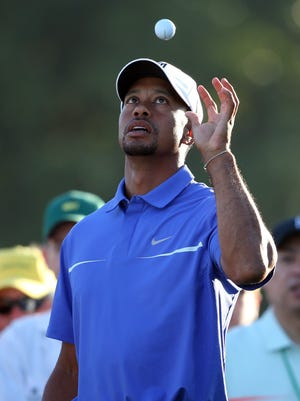 AUGUSTA, GA - APRIL 10:  Tiger Woods of the United States catches a ball during a practice round prior to the start of the 2013 Masters Tournament at Augusta National Golf Club on April 10, 2013 in Augusta, Georgia.  (Photo by Andrew Redington/Getty Images)