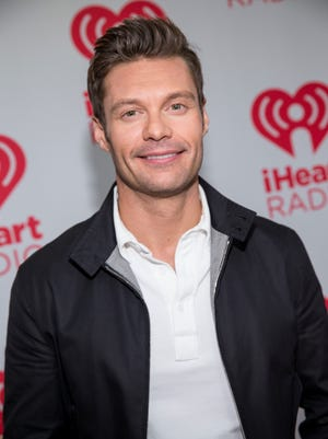 Ryan Seacrest arrives at the iHeartRadio Music Festival, Sept. 20, 2013, at the MGM Grand Garden Arena in Las Vegas.