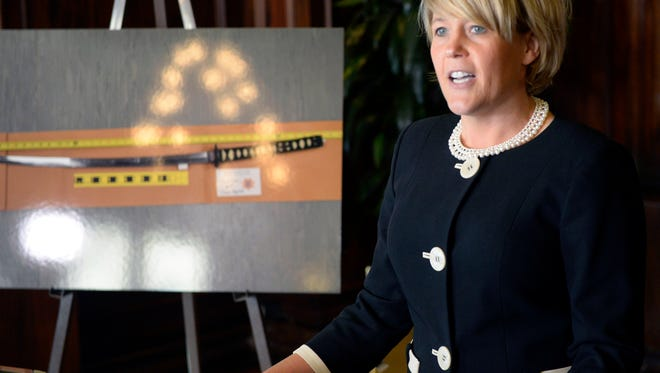 Attorney Heather White, representing Saratoga Springs and two of its police officers, speaks at a news conference held in response to a civil rights lawsuit against the officers, on Wednesday, Feb. 4, 2015, in Salt Lake City.