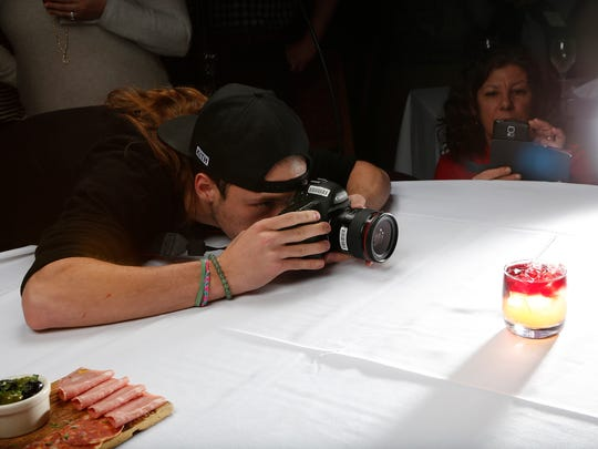 Drink and Click events allow guests to test popular cameras with provided lights and models for free. Guests can try Panasonic and Camera West products at La Quinta Brewing Co. on Nov. 7, 2019.