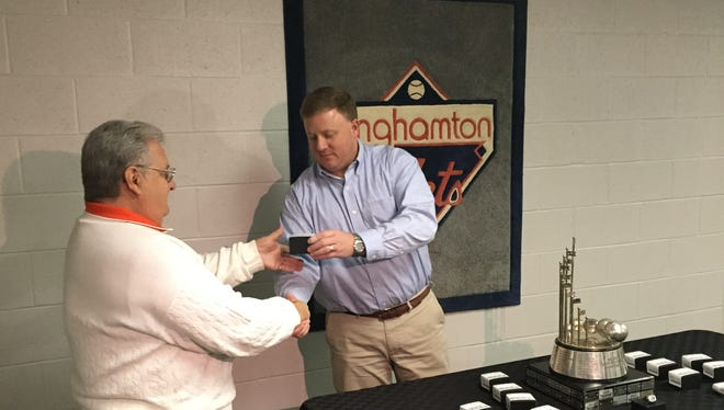 Binghamton Mets general manager Jim Weed, right, presents an Eastern League championship ring to longtime employee Lou Ferraro