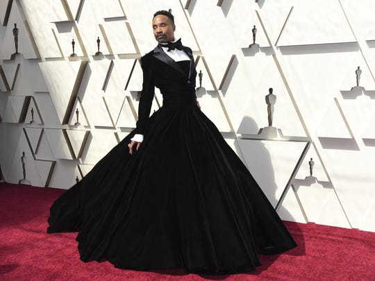"""Billy Porter wears a black velvet tuxedo gown by Christian Siriano at the Oscars in Los Angeles. The gown was worn again for """"Sesame Street."""""""
