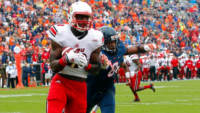 Sep 13, 2014; Charlottesville, VA, USA; Louisville Cardinals tight end Charles Standberry (80) catches the ball for a touchdown as Virginia Cavaliers safety Anthony Harris (8) defends in the first quarter at Scott Stadium. Mandatory Credit: Geoff Burke-USA TODAY Sports