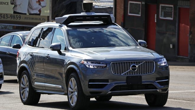 This March 17, 2017, photo shows an Uber self-driving Volvo in Pittsburgh. Uber, which halted its self-driving car program after the death of a pedestrian in March, will return one or two self-driving cars to public roads in Pittsburgh on Thursday, the company said.